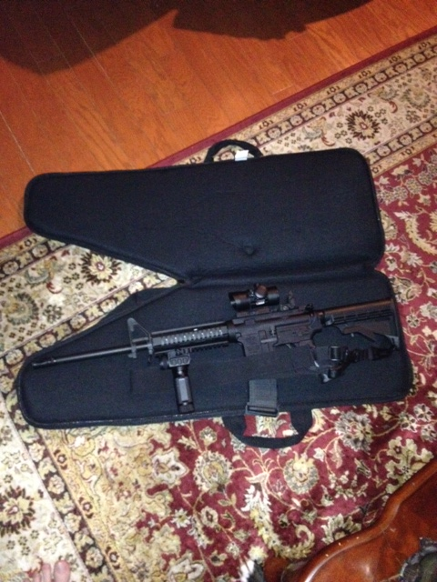 my AR-15 murse (don't judge me). Amanda- my AR in her purse: holds 4 magazines, and has a pocket for a box of ammo.